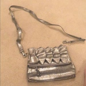 Clutch or across the body purse. (Never been used)